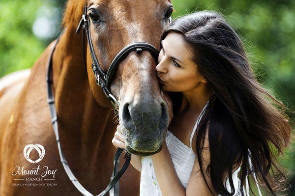 mount joy ranch girl kissing horse